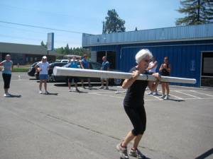 Check out Shirley McNair dancing with her slosh pipe while her fellow CrossFitters cheer her on!!!