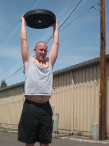 Brian Stewart performing an overhead lunge